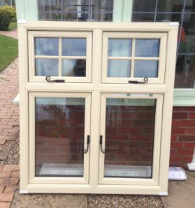Residence 9 timber effect uPVC window in cream with ironmongery handles. Wooden window effect by Mendip Conservatories.